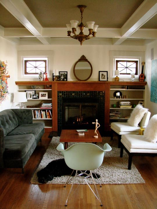 This room makes me smile. So many quirky and personal details that create a comfy, livable space. {Apartment Therapy}