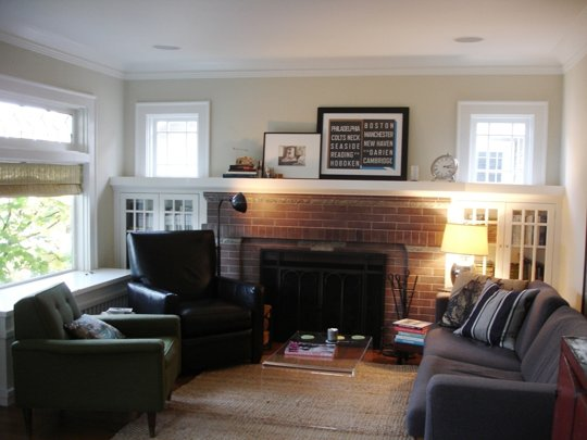 This Seattle home captures so much of the romance my imagination conjures up with Craftsman homes: brick, paned windows and bookcase doors, and intimately arranged seating.